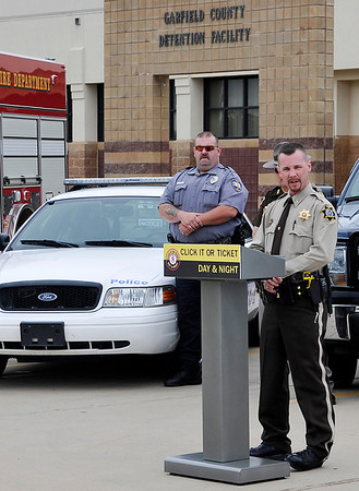 Garfield County Undersheriff John Marshall talks to those gathered at the Garfield County detention center Monday to kickoff the Click it or Ticket campaign. (Staff Photo by BILLY HEFTON)
