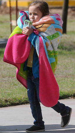 A young girl bundles up for the Tri-State Million Dollar Parade in downtown Enid Saturday, May 4, 2013. (Staff Photo by BONNIE VCULEK)