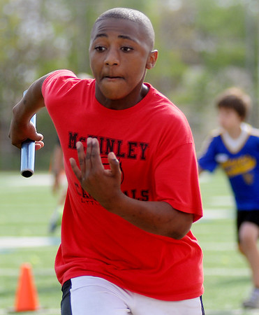 McKinley Cardinals' Telin Phillips sprints to the finish line during the 4 x 50 relay at the 73rd annual Kiwanis Little Olympics at D. Bruce Selby Stadium Wednesday, May 8, 2013. The Cardinals' relay team of Ryan Felber, Justin Sleeker, C.J. Bennett and Phillips placed first during the event. (Staff Photo by BONNIE VCULEK)