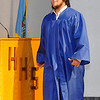 """Jesus C. """"Car"""" Aguirre bites his lip as he walks across the stage to pick up his diploma during the Hennessey High School commencement ceremony Friday. (Staff Photo by BILLY HEFTON)"""