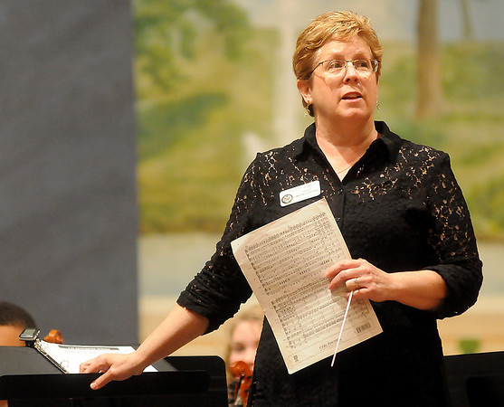 Summit Middle School instructor, Christy Fine, addresses the judges during the 81st annual Tri-State Music Festival orchestra competition at the Enid Symphony Center Thursday, May 2, 2013. (Staff Photo by BONNIE VCULEK)