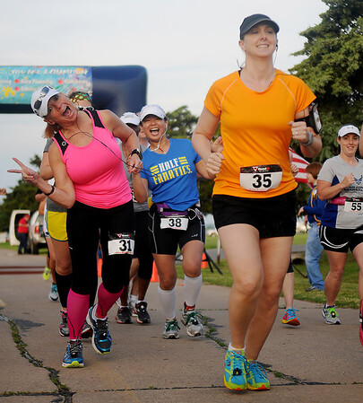 Half marathon enthusiasts begin the Woodring Wall of Honor Red Dirt Run of Honor at Enid Woodring Regional Airport Saturday, May 25, 2013. (Staff Photo by BONNIE VCULEK)