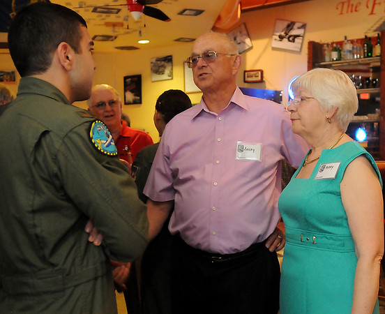 As Mary Bogemann listens (right), Larry Bogemann (center), a retired pilot from Vance Air Force Base's Class 63-6  from Springfield, Ohio, visits with Class 13-09 student pilot Ali Chinisaz during Class 63-6's 50 year reunion Friday, May 10, 2013. (Staff Photo by BONNIE VCULEK)