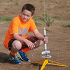 Jacob McCool prepares his B engine rocket for launching at Prairie View Elementary School Friday, May 10, 2013. (Staff Photo by BONNIE VCULEK)