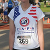 Karen Beattie, a gold star widow and Army soldier from Ft. Sill pauses at the 5K Woodring Wall of Honor Red Dirt Run of Honor starting line Saturday, May 25, 2013. Beattie will host a run in Qatar next year, a sister run to the one at Enid Woodring Regional Airport. (Staff Photo by BONNIE VCULEK)