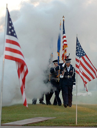 The Silver Talons emerge from behind a smoke screen to present the colors during the opening ceremony for the traveling Vietnam Wall May 20. (Staff Photo by BILLY  HEFTON)