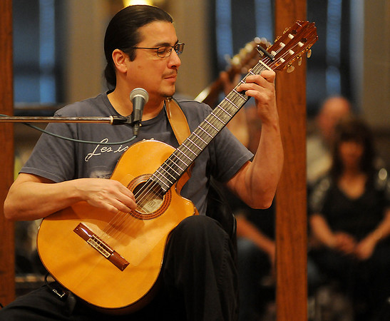 Edgar Cruz entertains his guests during a free guitar clinic in the Highland Partners Ballroom Friday, May 3, 2013. (Staff Photo by BONNIE VCULEK)