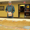 Albert Stehno, co-author of The Vanished Herd, pauses near the Cherokee Strip Cow Punchers Association buffalo hide at the Cherokee Strip Regional Heritage Center Wednesday, May 8, 2013. Stehno was in Enid to view the hide, harvested in the 1920s at the 101 Ranch and designed from 1932-1934 for the association. (Staff Photo by BONNIE VCULEK)