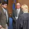 New Enid city commissioners, Ben Ezzell (right) and Rodney Timm, take the oath of office from Municipal Court Judge Linda Pickens Monday at the Enid City Hall. (Staff Photo by BILLY HEFTON)