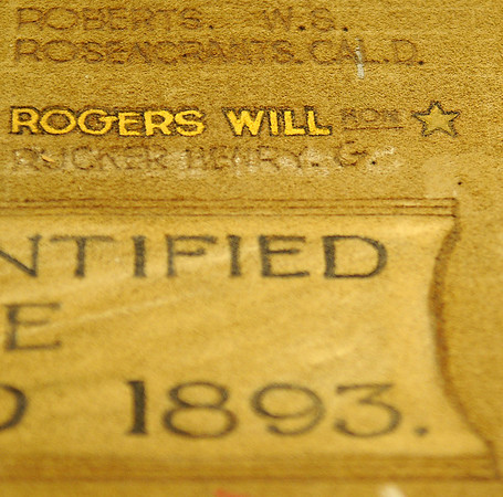 Among the names on the Cherokee Strip Cow Punchers Association buffalo hide was Oklahoma's Will Rogers. The star after Rogers' name signifies that he had died. The large buffalo hide is part of the Cherokee Strip Regional Heritage Center collection. (Staff Photo by BONNIE VCULEK)