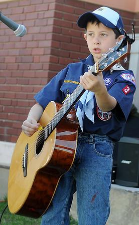 Wyatt Wilson entertains the crowd at Enid Farmers Market Saturday, May 11, 2013. (Staff Photo by BONNIE VCULEK)