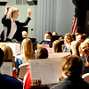 Tina Zollinger conducts the honor band during the Tri-State grand concert Saturday at the Enid High School Auditorium. (Staff Photo by BILLY HEFTON)