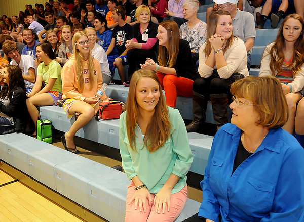 Peyton Isbell (front, center) a student at Waukomis High School,  visits with math instructor, Joan Hampton, before Isbell was awarded an Oklahoma anti-littering art contest award for her 50 second video production Wednesday, May 1, 2013. (Staff Photo by BONNIE VCULEK)