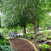 Jon and Diane Ford's garden walkway at 3619 Willow Lake Lane (Staff Photo by BONNIE VCULEK)