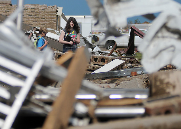 A Briarwood Elementary School teacher searches for items inside the tornado ravaged school in Moore, Okla. Tuesday, May 21, 2013. (Staff Photo by BONNIE VCULEK)