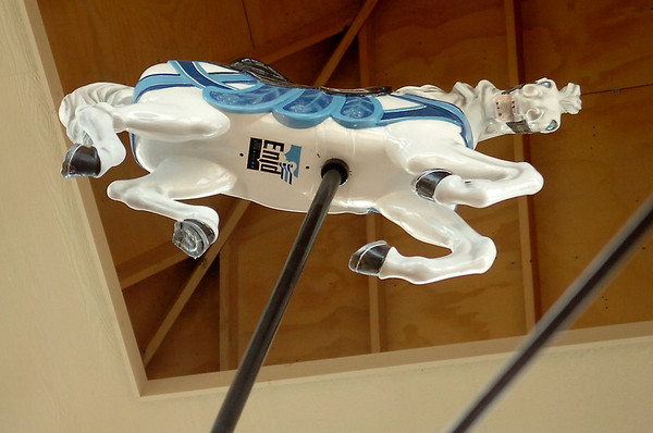 The Kiwanis Carousel horse at the top of the Meadowlake Carousel House sports an Enid brand Thursday, May 15, 2014. The beautiful carousel has been restored and will open soon at Meadowlake Park. The City of Enid Tech Services employees completed the carousel construction after City Commissioner Mike Stuber and Richard Mitchell repainted the horses. The City of Enid will offer free rides for the first two weeks after the ride's grand opening Memorial Day. (Staff Photo by BONNIE VCULEK)