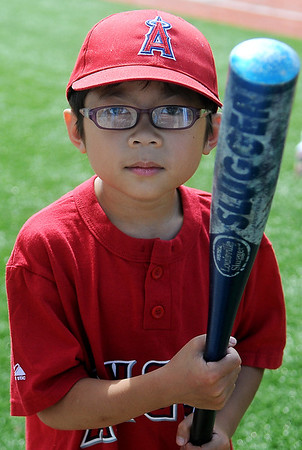 Zane Litson, a slugger for the Angels, pauses for a photo as he heads to the plate during Miracle League games at AMBUCS ABC Park Saturday, May 31, 2014. (Staff Photo by BONNIE VCULEK)