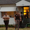 Law enforcement officers from the Garfield County Sheriff Department, Oklahoma Highway Patrol, Oklahoma Bureau of Narcotics and Enid Police Department conduct a drug sweep Thursday, May 8, 2014. (Staff Photo by BONNIE VCULEK)