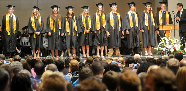 Mr. Dallas Caldwell (far right) recognizes valedictorians and salutatorians during the academic honors presentation at Oklahoma Bible Academy's Class of 2014 commencement exercises Friday, May 23, 2014. (Staff Photo by BONNIE VCULEK)