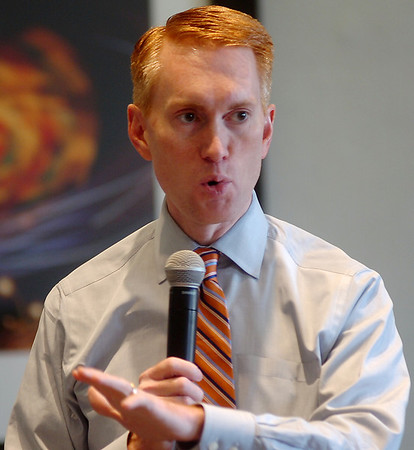 James Lankford, a candidate for US Senate, speaks to Enid residents in the Nick Benson Memorial Ballroom in the Enid Event Center and Convention Hall Thursday, May 15, 2014. (Staff Photo by BONNIE VCULEK)
