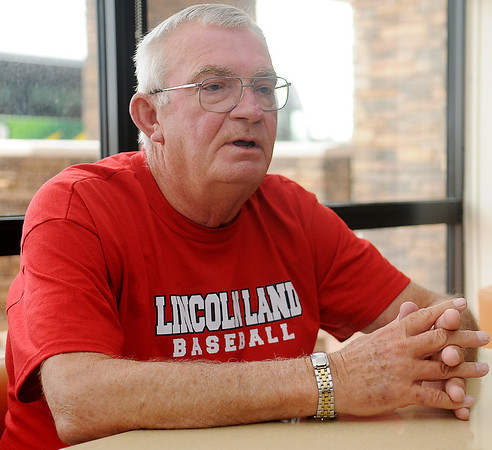 Ron Riggle, a Lincoln Land Community College baseball enthusiast, answers questions during an interview at the Springhill Suites Saturday, May 24, 2014. Riggle's son is the head coach of the Lincoln Land Community College in Springfield, Illinois. (Staff Photo by BONNIE VCULEK)