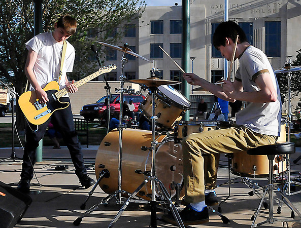 Brothers, Griffin and Logan Bush, of the band Kill Vargas from Wichita, Kansas perform during the first ever Garage Band competition in the Tri-State music festival Thursday at the courthouse gazabo. (Staff Photo by BILLY HEFTON)
