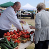 Michael Alcorn helps a customer with a green bean purchase at Enid Farmers Market Saturday, May 17, 2014. (Staff Photo by BONNIE VCULEK)