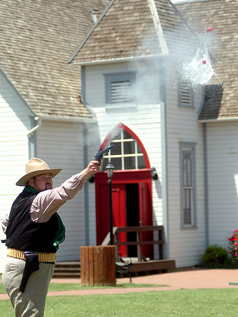Cody Jolliff shoots a water balloon from the sky as he practices his trick shooting at Humphrey Heritage Village Wednesday, May 14, 2014. Cherokee Strip Regional Heritage Center hosts the Frontier Festival Town Social & Dance, Carnival and Fried Chicken Box Supper at Humphrey Heritage Village  Saturday, May 17. (Staff Photo by BONNIE VCULEK)