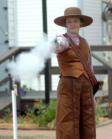 Sarah Owens shoots a purple balloon as she practices her trick shooting at Humphrey Heritage Village Wednesday, May 14, 2014. Cherokee Strip Regional Heritage Center hosts the Frontier Festival Town Social & Dance, Carnival and Fried Chicken Box Supper at Humphrey Heritage Village  Saturday, May 17. (Staff Photo by BONNIE VCULEK)