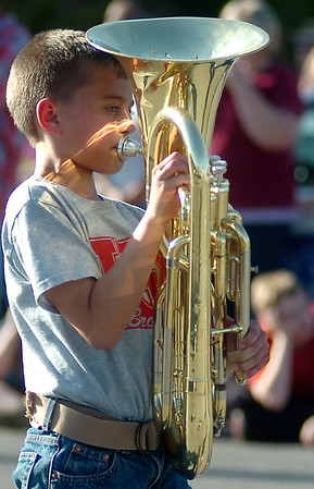 Reflecting sunlight dances across the face of a Kremlin-Hillsdale Elementary Band student as he marches during the 82nd annual Tri-State Parade Friday, May 2, 2014. (Staff Photo by BONNIE VCULEK)