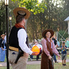 Cody Jolliff tips his hat for Tennessee Owens during trick shooting at the Frontier Festival Town Social & Dance Saturday, May 17, 2014. (Staff Photo by BONNIE VCULEK)