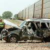 Enid Police officers and BNSF officials investigate the collision between a train and SUV north of the intersection of 42nd and Owen K. Garriott Tuesday, May 6, 2014. Life EMS transported the driver of the vehicle to St. Mary's Regional Medical Center. The Enid Fire Department; Enid Police Department, Life EMS, and BNSF officials responded to the scene. (Staff Photo by BONNIE VCULEK)
