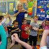 "Joan Dodds, the pre-K teacher at Northern Oklahoma College, sings ""Ittsy Bitsy Spider"" with her students Thursday, May 15, 2014. After morning activities in the classroom, Dodds walks her students across Randolph to the Adams Elementary School cafeteria for lunch before returning for outside games. (Staff Photo by BONNIE VCULEK)"