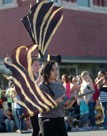 Waller Middle School flag corp entertain the audience along the 82nd annual Tri-State Music Festival parade route Friday, May 2, 2014. (Staff Photo by BONNIE VCULEK)