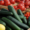 Vegetables fill a table at Enid Farmers Market Saturday, May 17, 2014. (Staff Photo by BONNIE VCULEK)