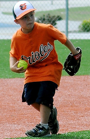 Orioles' Caleb Moulton snags an Angel hit during the Miracle League game at AMBUCS ABC Park Saturday, May 31, 2014. (Staff Photo by BONNIE VCULEK)