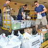 Vitaliy Benz, Sam Schmidt and Scott Addy sort donated food items Saturday during the postal carriers food drive. (Staff Photo by BILLY HEFTON)