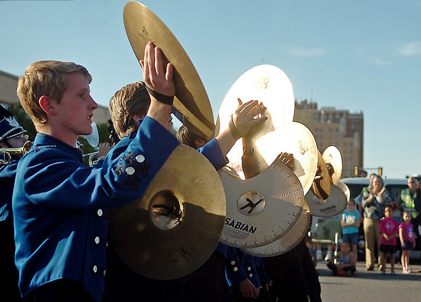 """The audience applauds as Enid High School's Big Blue Band plays """"Oklahoma"""" as they march east on Maine during the 82nd annual Tri-State Parade Friday, Mary 2, 2014. (Staff Photo by BONNIE VCULEK)"""
