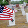 United States flags mark the grave sites of veterans at Enid Cemetery on Memorial Day weekend Friday, May 23, 2014. (Staff Photo by BONNIE VCULEK)