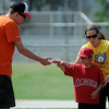 Orioles' Dakotah Tollet (left) and Angels' Zane Litson high five during the Miracle League games at AMBUCS ABC Park Saturday, May 31, 2014. (Staff Photo by BONNIE VCULEK)