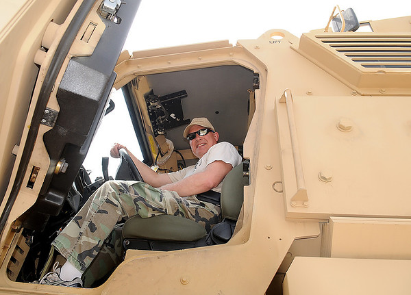 Lt. Gary Fuxa sits behind the wheel of the Enid Police Department's Army surplus armored personnel carrier Tuesday, May 20, 2014. Lt. Fuxa was instrumental in obtaining the vehicle for the Enid Police Department through a grant request. The only cost to the department was the $2500 delivery fee. (Staff Photo by BONNIE VCULEK)