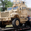 Sgt. Justin Hodges, with the Enid Police Department, steps down from the department's Army surplus armored personnel carrier Tuesday, May 20, 2014. The SWAT vehicle, transported by J & B Heavy Haul from Oklahoma City, was awarded to the Enid Police Department after a two-year grant process was completed by Lt. Gary Fuxa. (Staff Photo by BONNIE VCULEK)