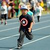 Children run the 50-yard dash during the 5th annual Be Fit Kids Buzz Run at Enid High School Saturday, May 17, 2014. (Staff Photo by BONNIE VCULEK)