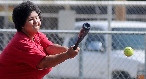 Angels' Kayla Payne connects with a pitch during a Miracle League game at AMBUCS ABC Park Saturday, May 31, 2014. (Staff Photo by BONNIE VCULEK)