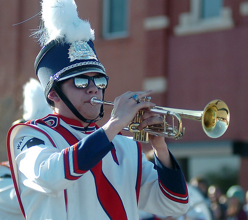 Guests along East Maine are reflected in the glasses of a Waukomis High School Band member as he marches during the 82nd Tri-State Parade Friday, May 2, 2014. (Staff Photo by BONNIE VCULEK)