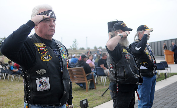 Rolling Thunder Patriot Guard members salute after posting additional names to the Vietnam Memorial Wall at Enid Woodring Regional Airport during a special ceremony Friday, May 16, 2014. (Staff Photo by BONNIE VCULEK)