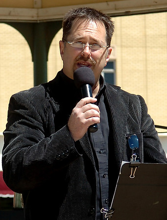 Brad Mendenhall, from World Harvest Church, welcomes guests to the National Day of Prayer service on the Garfield County Courthouse lawn Thursday, May 1, 2014. (Staff Photo by BONNIE VCULEK)