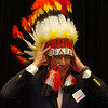 Jack Bellware (left), the AMBUCS National President, dons a traditional Indian head dress presented to him by Enid AMBUCS President Ryan Jackson during the noon luncheon in the NOC Enid Gantz Center ballroom Friday, May 2, 2014. The colorful head dress is presented to each national president when they visit with the Enid AMBUCS organizations. (Staff Photo by BONNIE VCULEK)