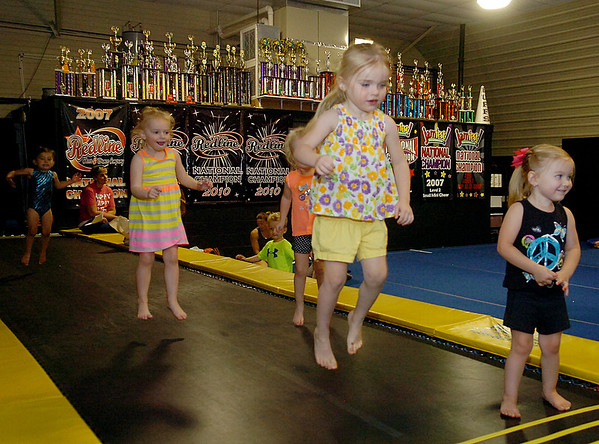 """Mini-Tots bounce on a mat at Spirit Express Wednesday, May 7, 2014. Spirit Express has received the 2014 Readers' Choice Award for """"Best Cheerleading School."""" (Staff Photo by BONNIE VCULEK)"""