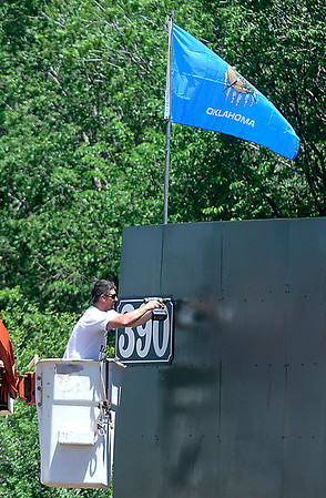 A man replaces the distance marker on the centerfield wall at David Allen Memorial Ballpark Friday after giving it new coat of paint. Preperations are being made for the NJCAA II World Series that will be played at the ballpark May 24-31. (Staff Photo by BILLY HEFTON)